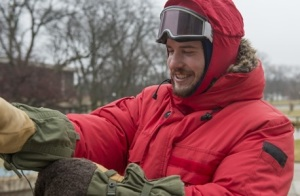 Jason Coenen tries on a set of Antarctic gear outside Davis Hall.