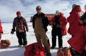 NIU geologists Ross Powell and Reed Scherer (holding camera) with other WISSARD team members. Credit: WISSARD