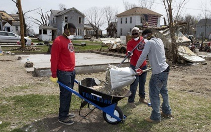 Members of the NIU football team assist with cleanup in Fairdale.