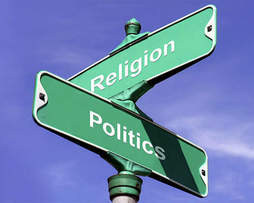 Road signs at intersection of Religion and Politics