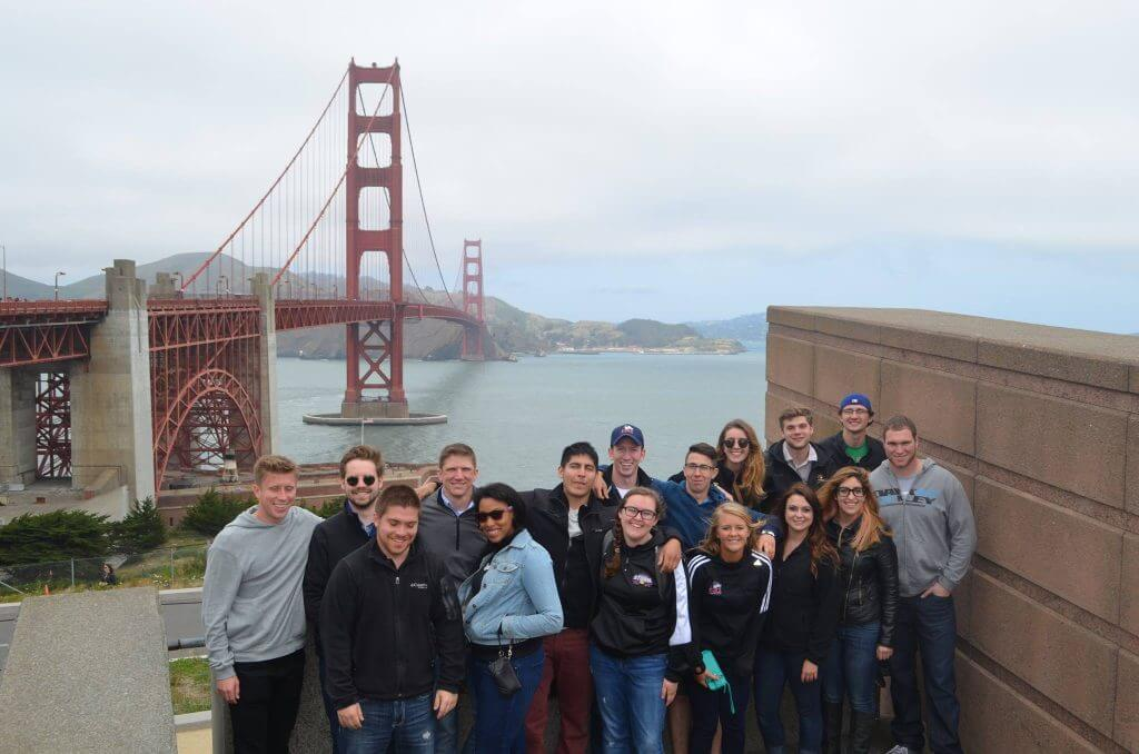 The Golden Gate Bride in San Francisco obligingly poses with students from the NIU College of Business.