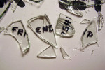 "Photo of the word ""FRIENDSHIP"" on shards of broken glass"