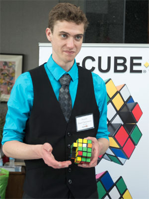 Dane Christianson, president of Moving Parts, LLC, demonstrates his X-Cube.