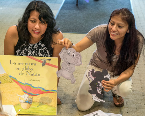 """""""Go Teacher"""" students from Ecuador at NIU's June 13 Literacy on the Lawn event."""
