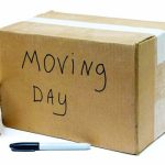 Photo of a moving box, a black Sharpie and packing tape