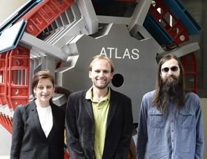 NIU postdoctoral student Nancy Andari (left) with professor Jahred Adelman (center) and Ph.D. student Blake Burghgrave at CERN.