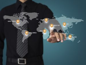 hand touch on world map for business travel concept