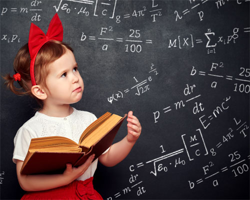 Photo of a kindergarten girl and a chalkboard covered in algebra