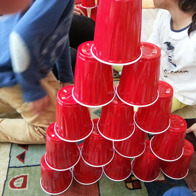 Photo of a tower of red plastic cups