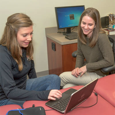 Becky Wagner (right) works with student Elizabeth Smith.