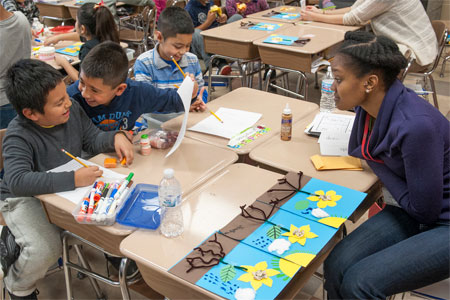 An NIU student works with Cortland Elementary School second-graders.