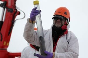 NIU Geology Professor Reed Scherer holds a sediment sample recovered from the grounding zone. Credit: WISSARD