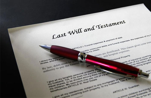 """Photo of a pen and a """"Last Will and Testament"""" form"""