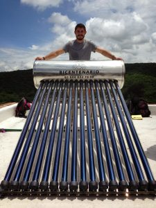 Taylor Dupre of Engineers without Borders with a solar water heater