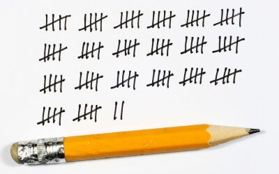 Photo of a pencil and tally marks