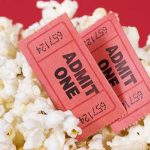 Photo of popcorn and movie tickets