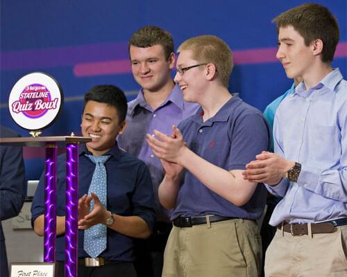 Members of the Rockford Auburn High School team celebrate their Stateline Quiz Bowl championship.