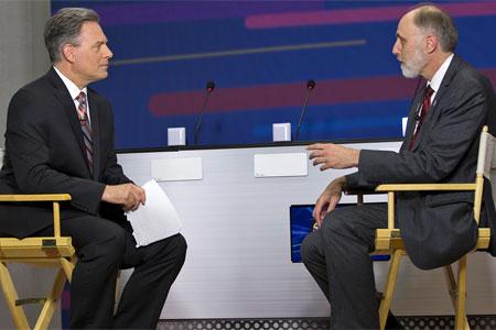 Toma interviews NIU President Doug Baker during the live pre-game show.