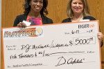 "FastPitch winner PJ McGuire, left, received the ""giant check"" from EIGERlab's Sherry Pritz for her Wraperoo."