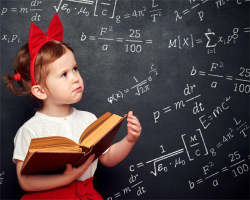 Photo of a kindergarten girl and a chalkboard covered in algebra