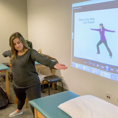 NIU student Karyn Kolner leads her classmates in the LSVT BIG exercises.