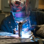 An NIU engineering student welding
