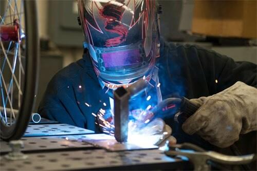 An NIU engineering student welding