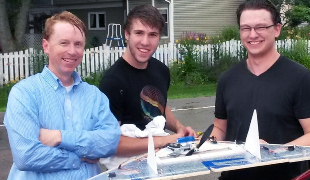 Professor Brianno Coller (left to right) with engineering students Kyle Bodie and David Frey