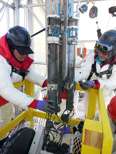 Northern Illinois University professors Ross Powell (left) and Reed Scherer gather up sediment core samples from a multi-corer during a 2012-13 expedition to Antarctica's Ross Sea region. Credit: Northern Illinois University